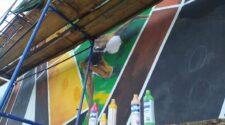 Робота над муралом на спорткомплексі УжНУ